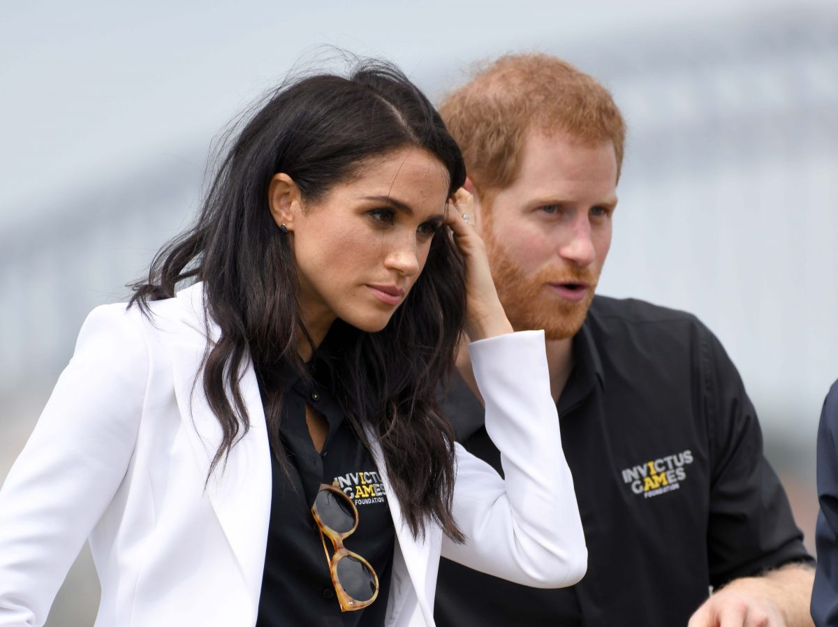 Prince Harry and Meghan Markle stand together at Invictus Games in Sydney, Australia