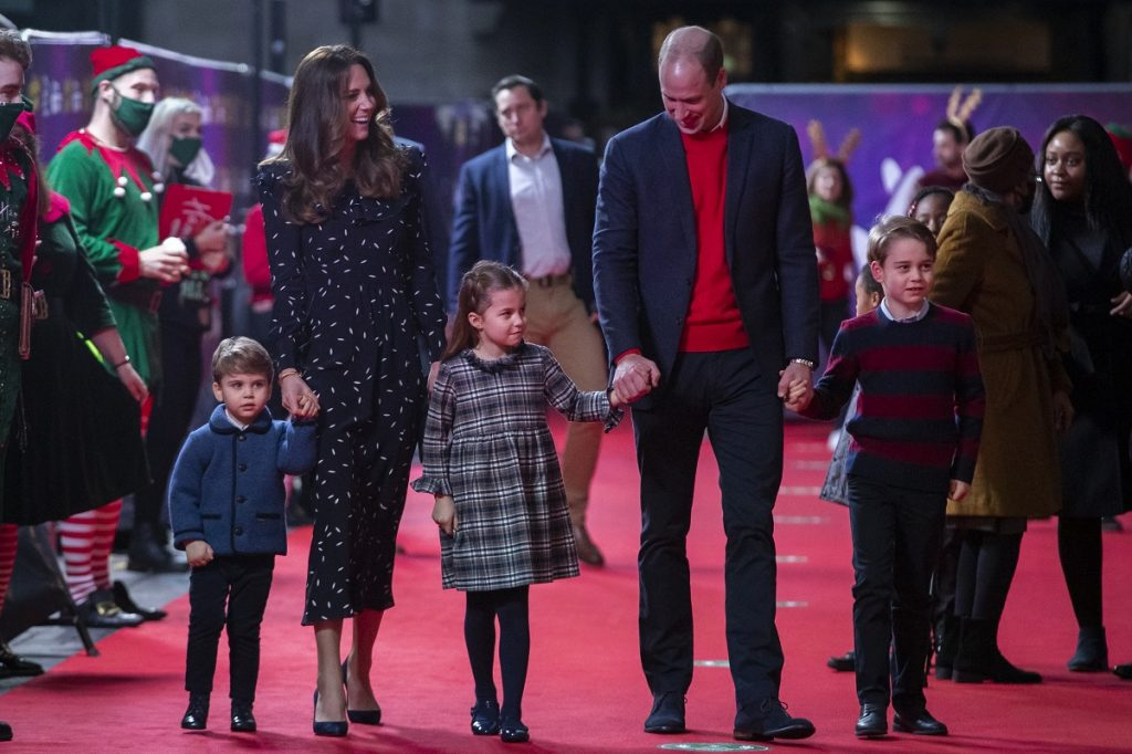 Prince William and Kate Middleton with their children at a performance in London