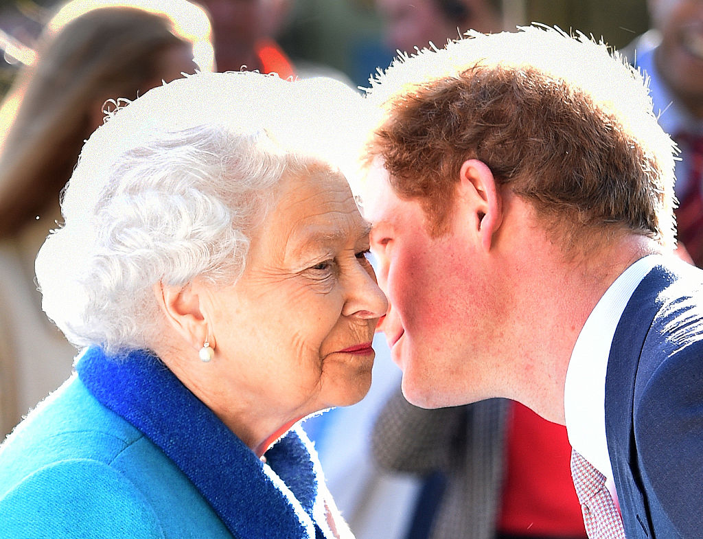 Queen Elizabeth II and Prince Harry greeting with an air kiss