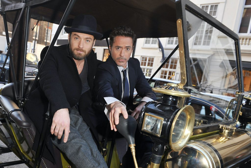 Robert Downey Jr., Jude Law of 'Sherlock Holmes: A Game Of Shadows' pose outside Claridges