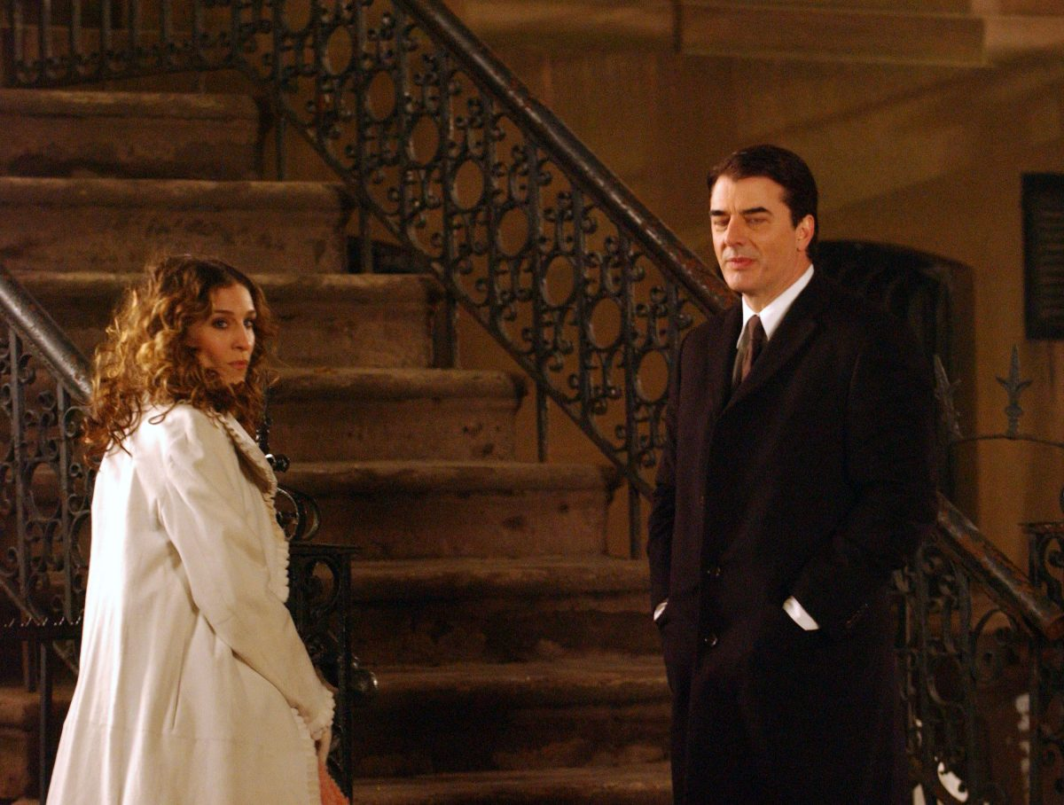 Sarah Jessica Parker as Carrie Bradshaw and Chris Noth as Mr. Big stand outside of her brownstone apartment in 'Sex and the City'