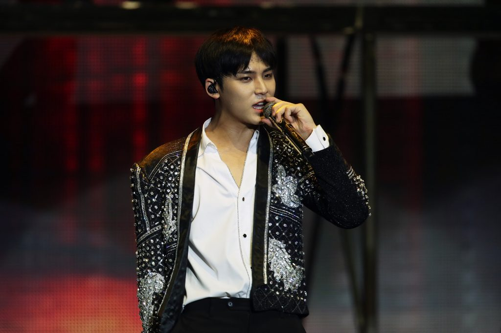 Mingyu of SEVENTEEN performing during the band's Ode to You tour in 2020