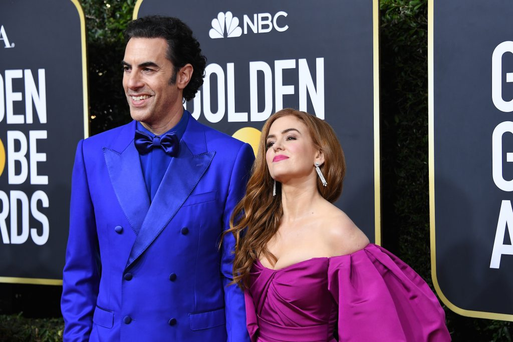 Sacha Baron Cohen standing next to his wife, Isla Fisher, at the Golden Globes