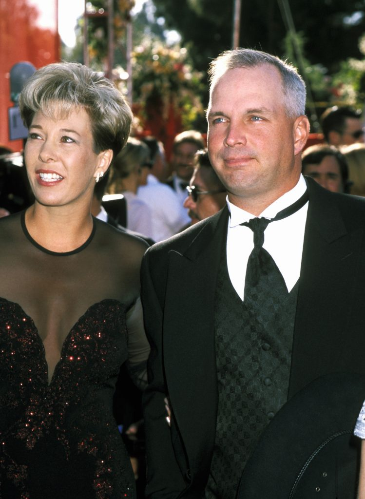 Garth Brooks with wife Sandy Mahl smiling together at the Academy Awards
