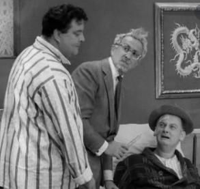 Character actor George Petrie, center, with (left) Jackie Gleason as Ralph Kramden and Art Carney (right) as Ed Norton in a scene from 'The Honeymooners'