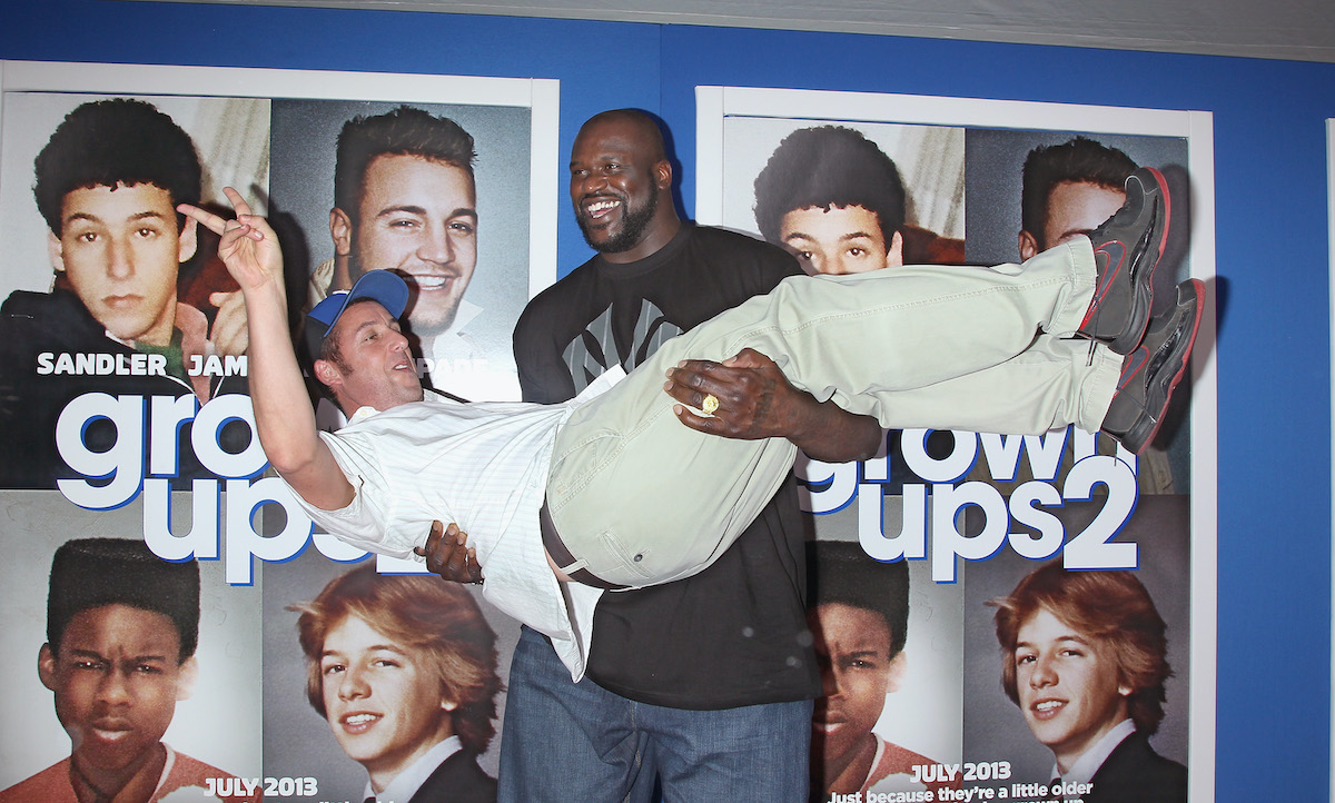 """Shaquille O'Neal carries Adam Sandler at the """"Grown Ups 2"""" New York Premiere"""