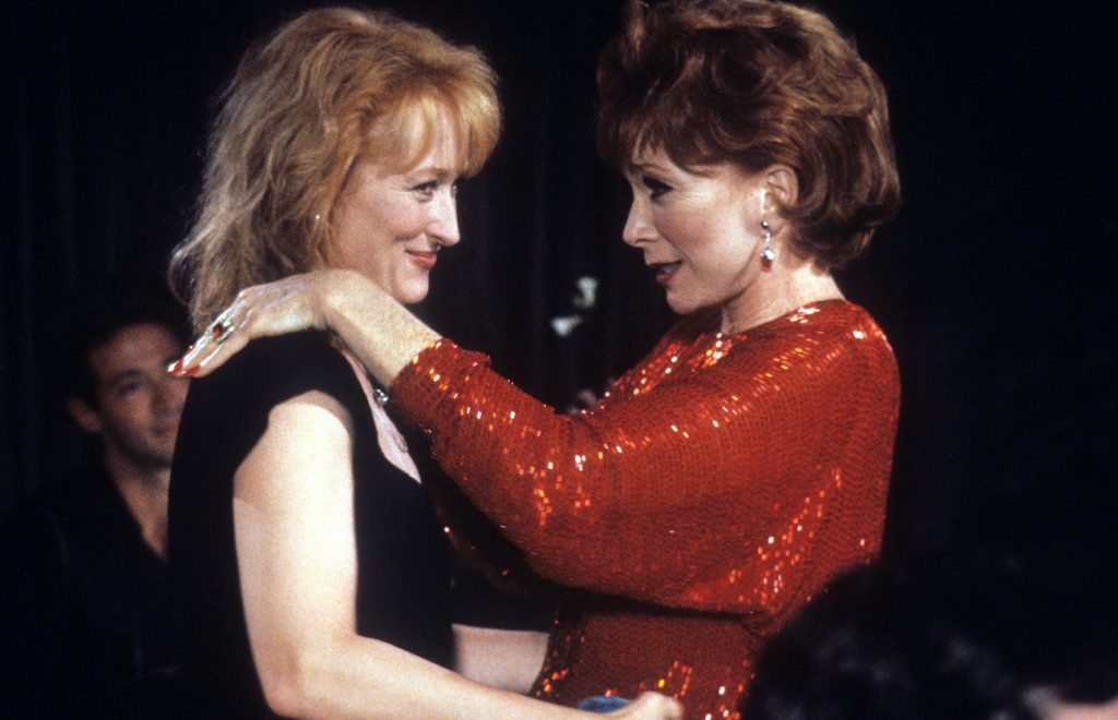Meryl Streep holds Shirley MacLaine in a scene from the film 'Postcards From The Edge', 1990