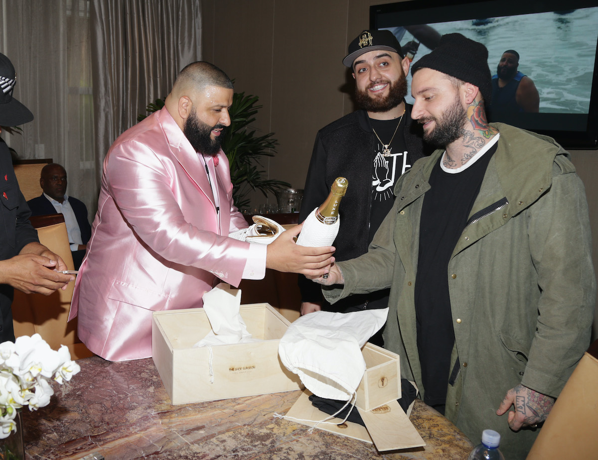 DJ Khaled receives a custom pair of Jordans from Dominic Chambrone aka The Shoe Surgeon at DJ Khaled Special Announcement Press Conference