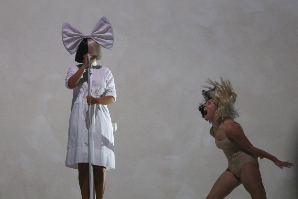 Sia and movie star Maddie Ziegler perform at concert