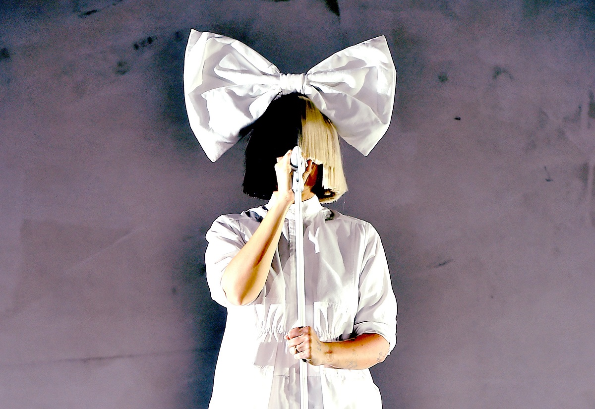 The singer Sia in a hairbow with a wig covering her face, performing in 2016 at Coachella