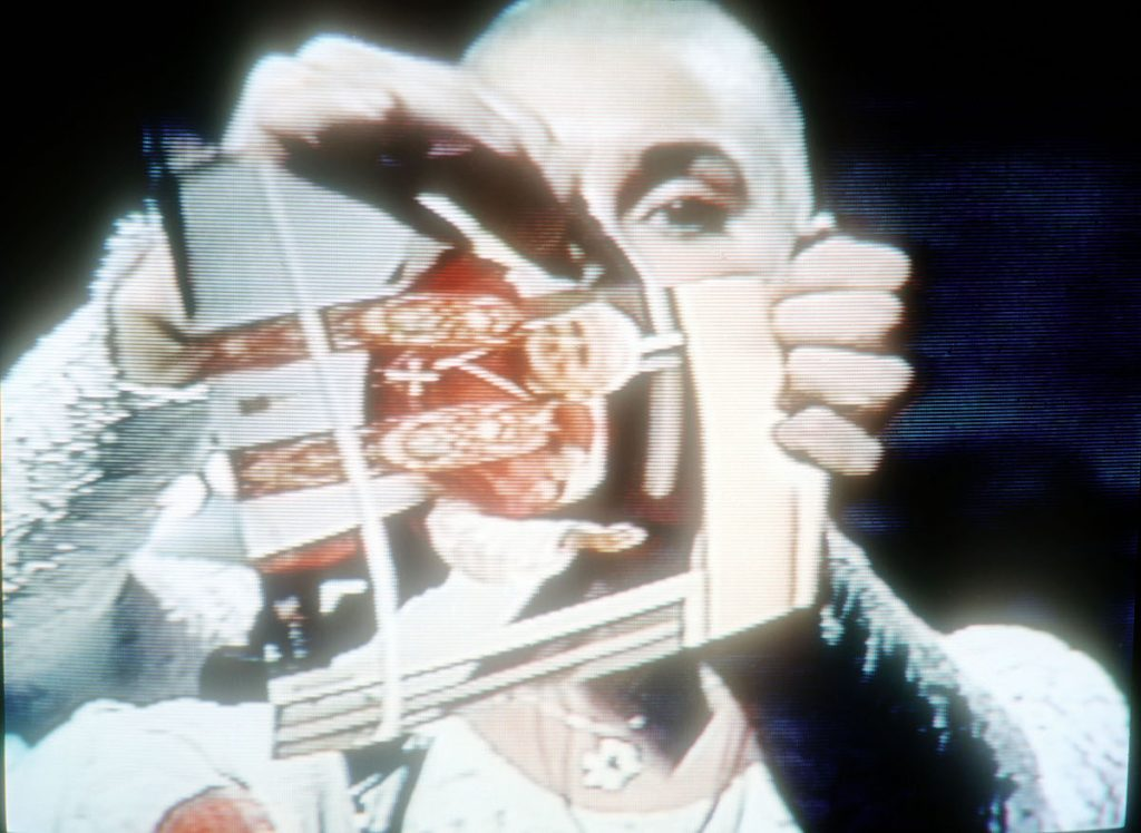 Video capture of singer Sinéad O'Connor ripping up a picture of Pope John Paul II on October 3, 1992, on the TV show 'Saturday Night Live' (AKA 'SNL')
