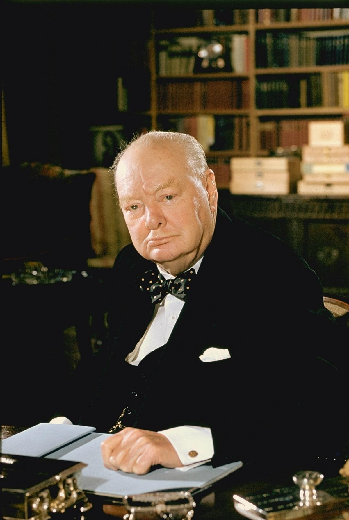 Formal portrait of Sir Winston Churchill at his desk