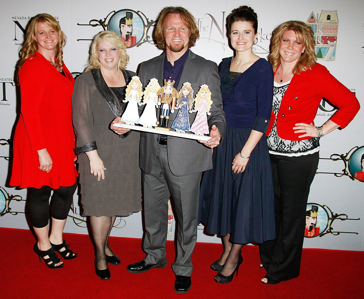 Christine, Janelle, Kody, Robyn, and Meri Brown of TLC's 'Sister Wives' holding a paper cut-out of fur princesses and a nutcracker on the red carpet at the Nevada Ballet Theatre's production of 'The Nutcracker' in 2012 in Las Vegas