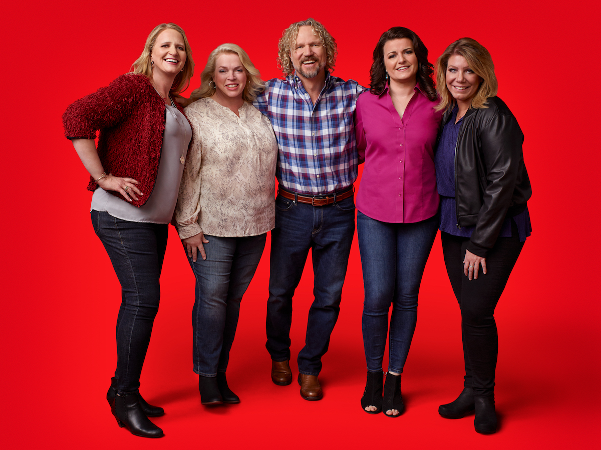 Kody Brown from Sister Wives surrounded by Christine Brown, Janelle Brown, Robyn Brown, and Meri Brown, on a red background