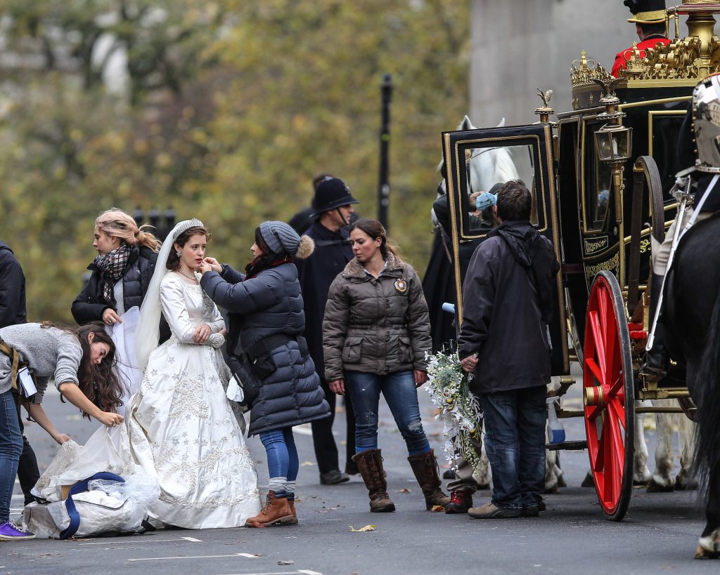 Claire Foy, cast of 'The Crown,' in a wedding dress as a young Queen Elizabeth II