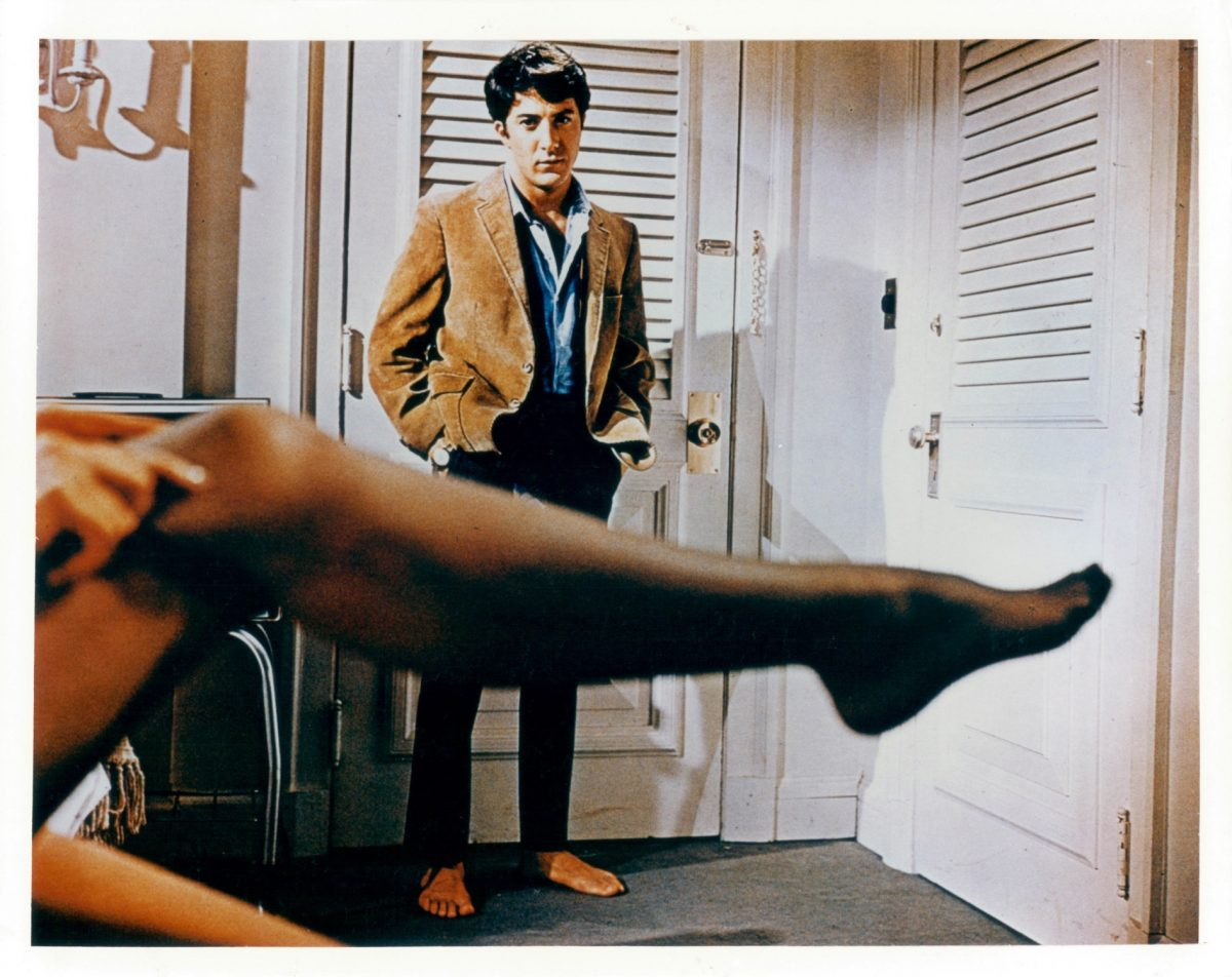 Anne Bancroft pulling on stocking in front of Dustin Hoffman in a scene from 'The Graduate'