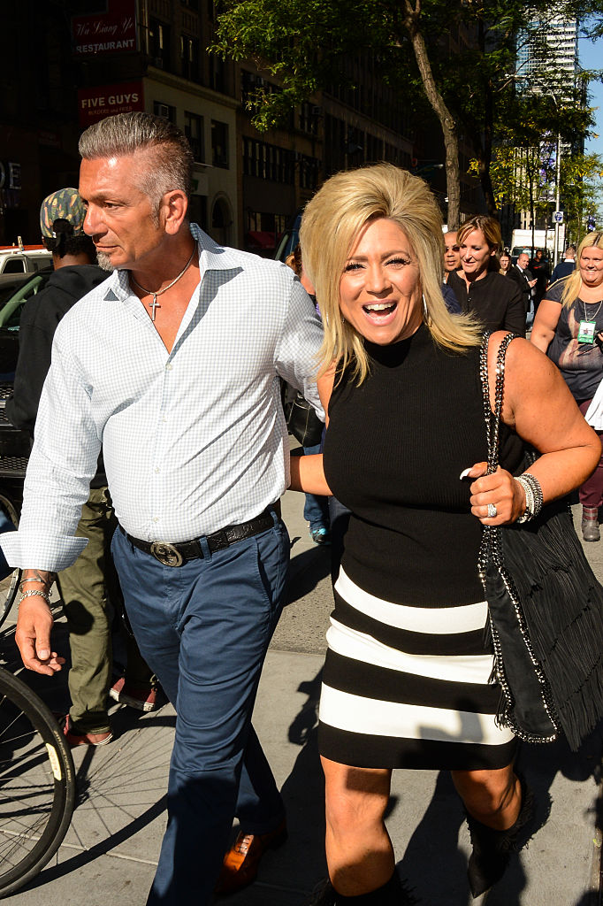 Larry Caputo (L) and Theresa Caputo from 'Long Island Medium walking on the sidewalk