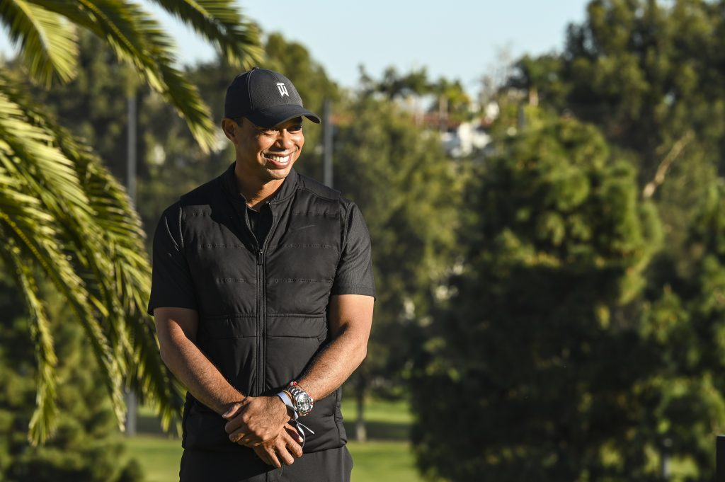 Tiger Woods smiles during the final round of The Genesis Invitational