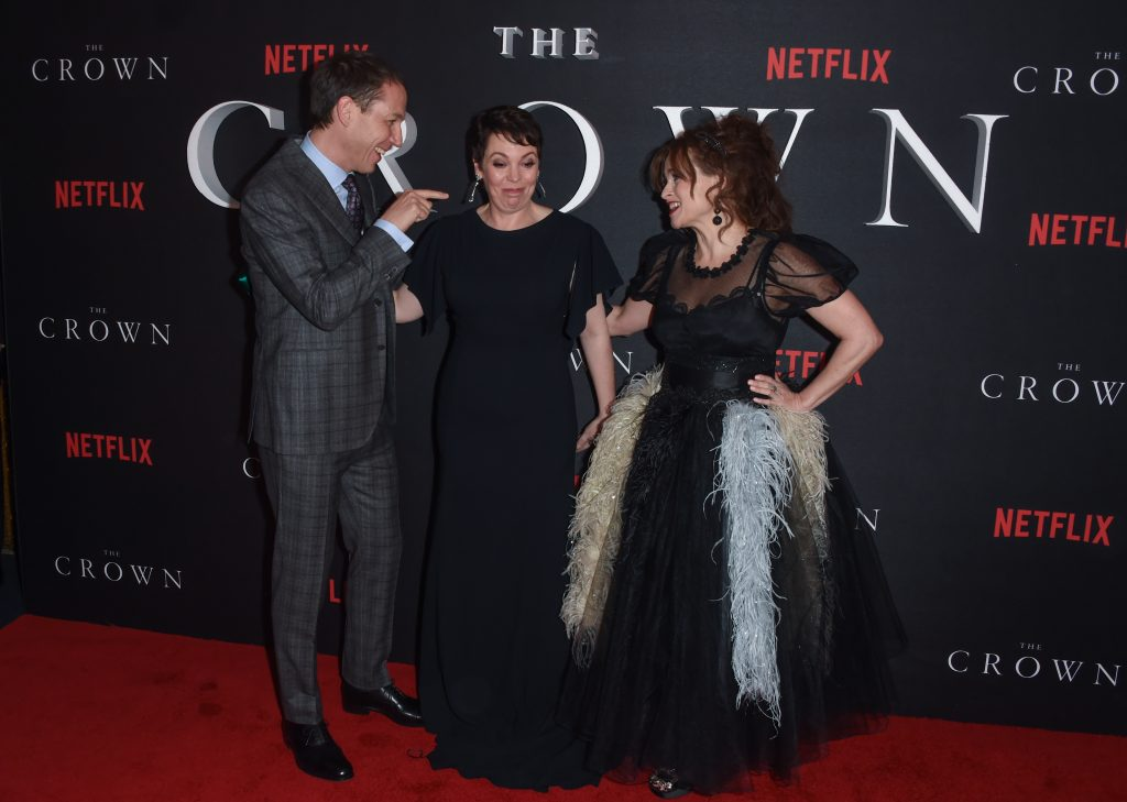 Tobias Menzies, Olivia Colman and Helena Bonham Carter laughing on red carpet at world premiere of The Crown