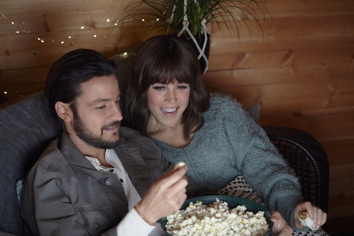 Tyler Hynes and Erin Krakow eating popcorn in It Was Always You