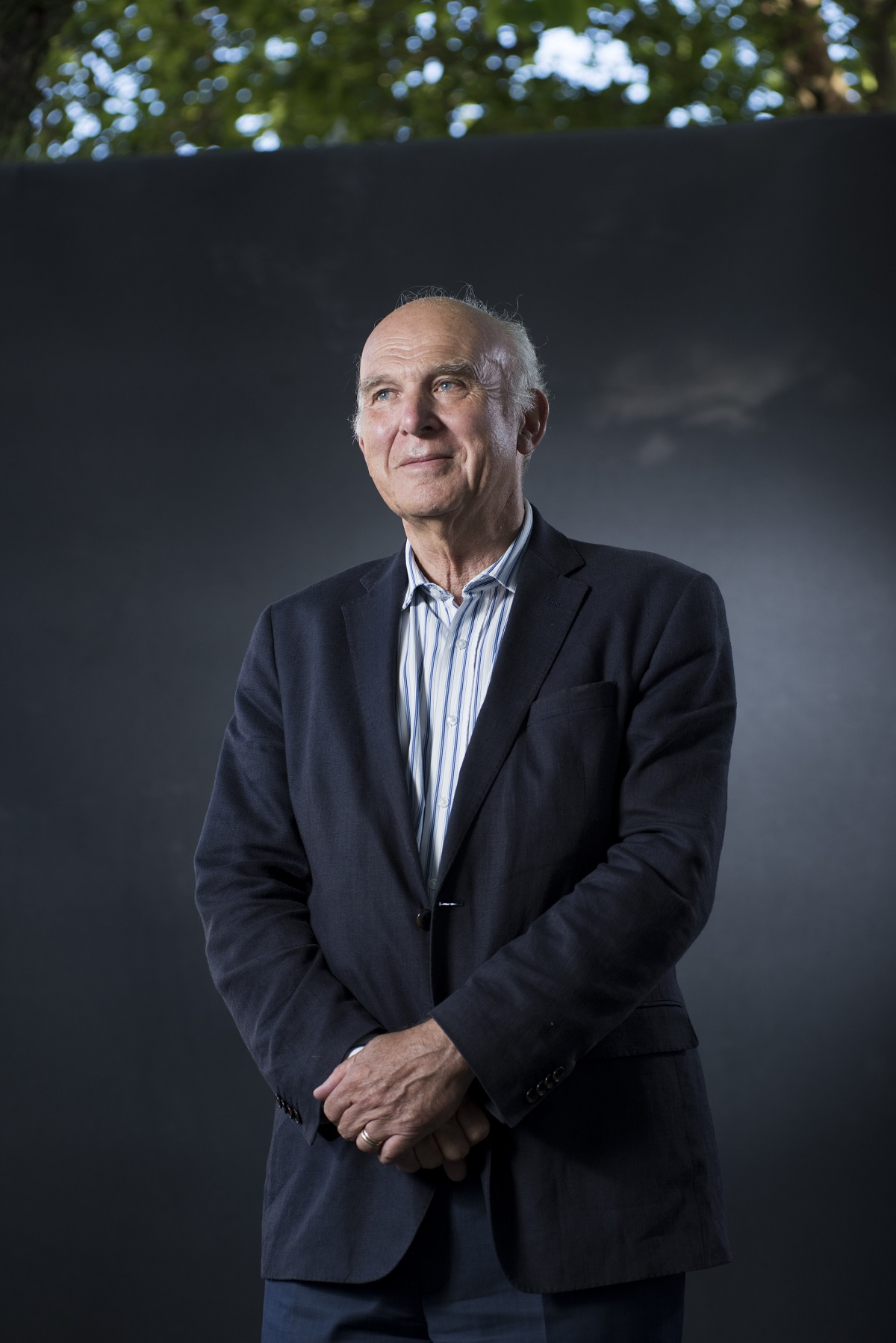 Vince Cable in a standing portrait at the Edinburgh Book Fair