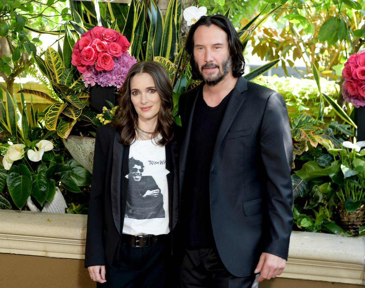 Winona Ryder and Keanu Reeves at a photo call for 'Destination Wedding'