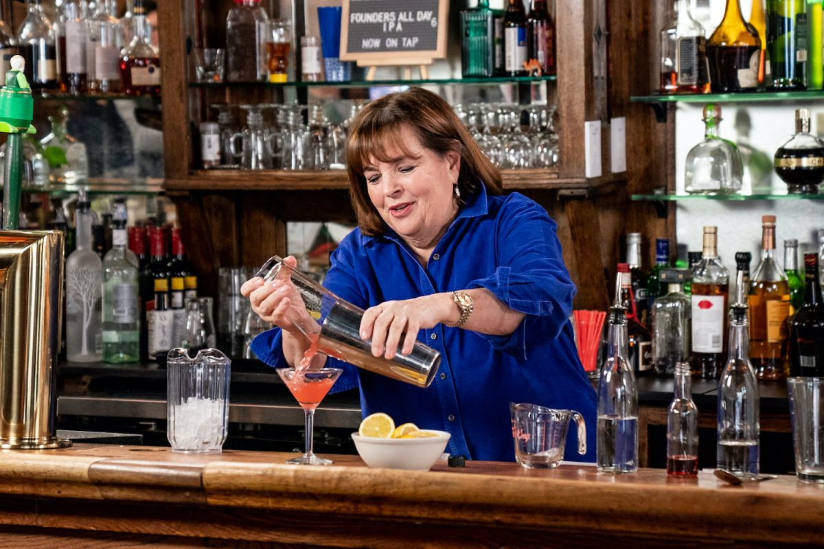 """Ina Garten pours a cosmopolitan cocktail at the bar during a segment on Late Night with Seth Meyers, """"Seth Goes Day Drinking with Ina Garten"""" in 2019"""