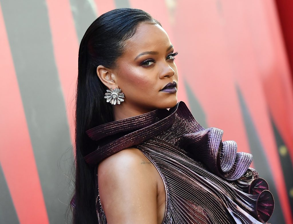 Rihanna with a red background