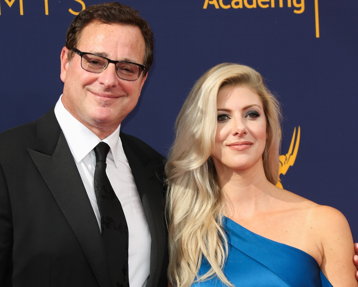 Bob Saget posing with his wife, Kelly Rizzo, in formal wear