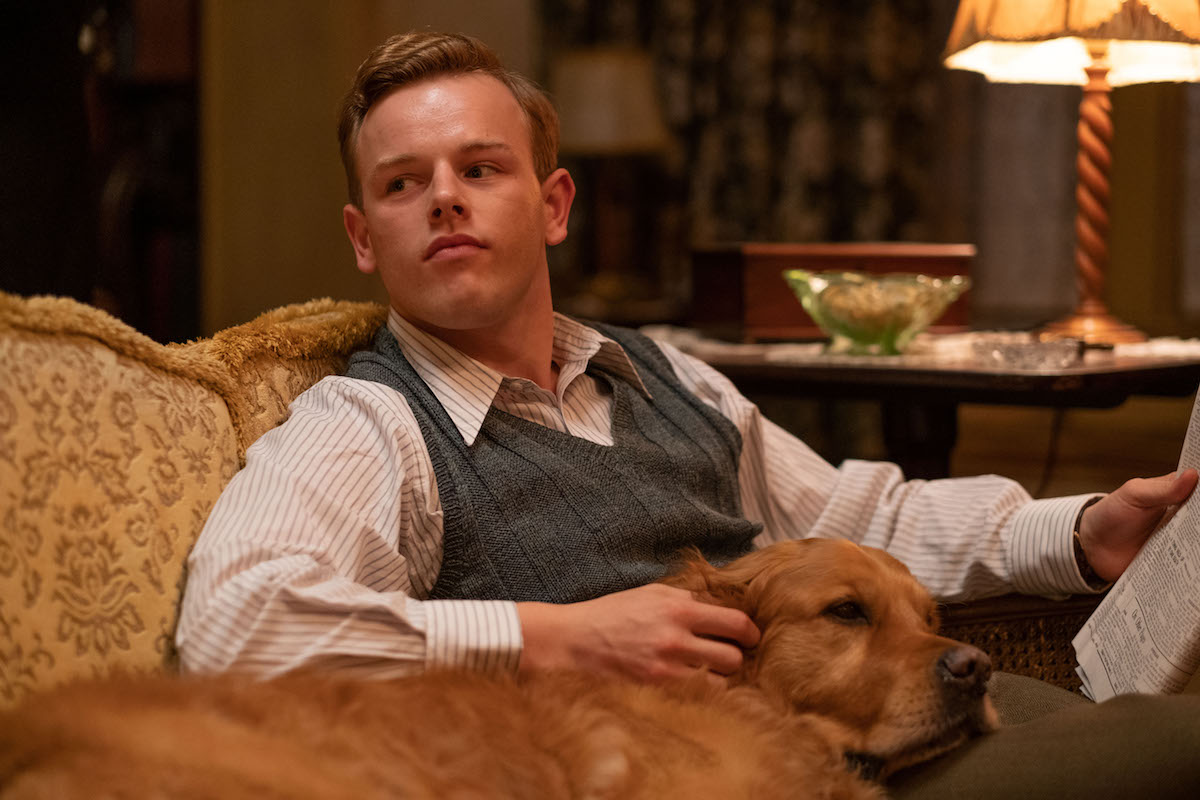Callum Woodhouse as Tristan petting dog in All Creatures Great and Small