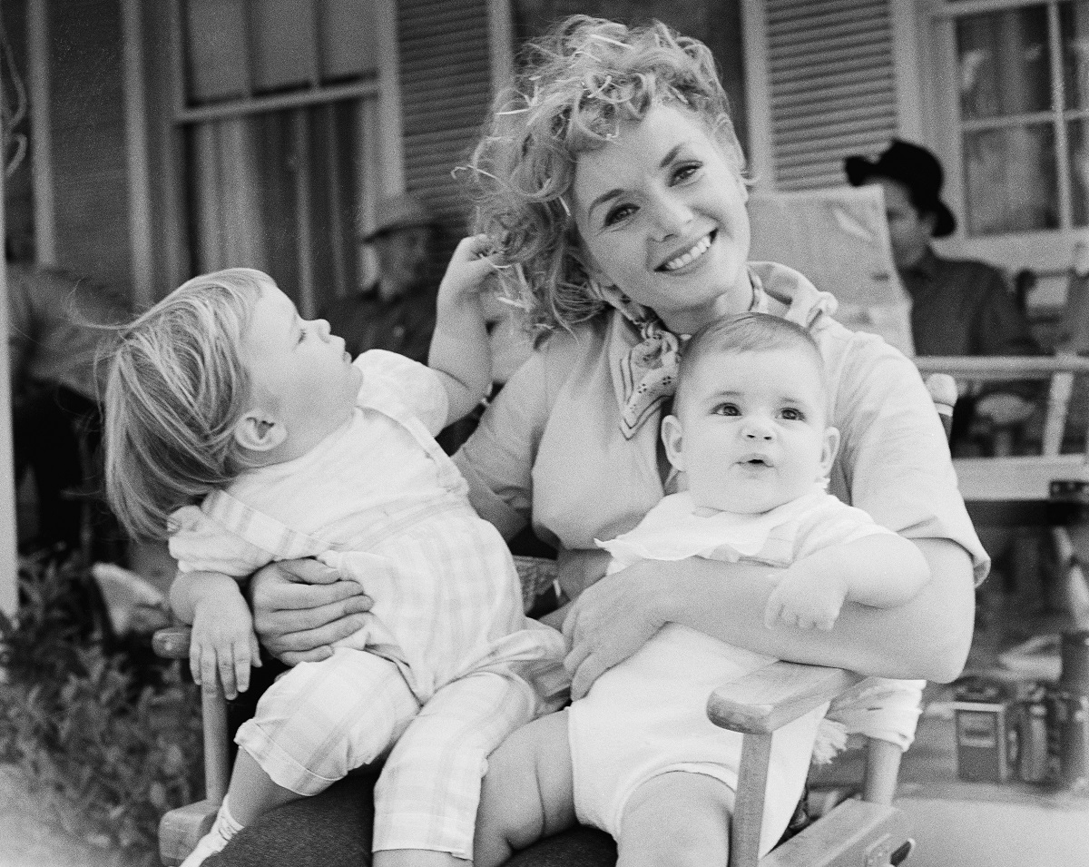 Debbie Reynolds holds her two children, Carrie and Todd, 8-mos, (right) in 1958.