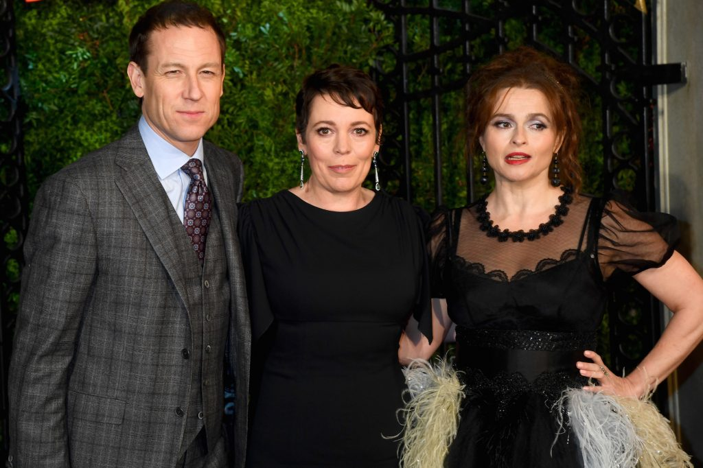 Cast of 'The Crown': Olivia Colman, Tobias Menzies, and Helena Bonham Carter standing together