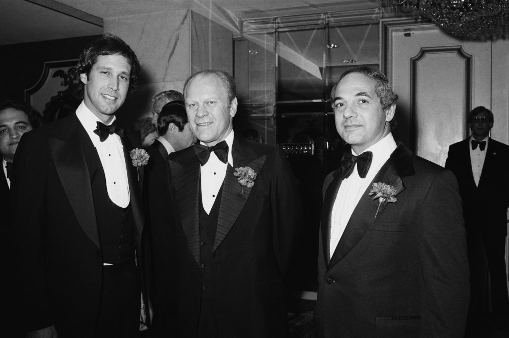Black and white photo of 'Saturday Night Live's Chevy Chase and Gerald Ford.