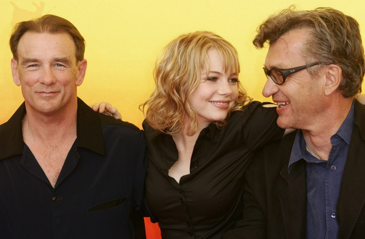 Diehl posing with Michelle Williams and Wim Wenders at 2004 Venice Film Festival