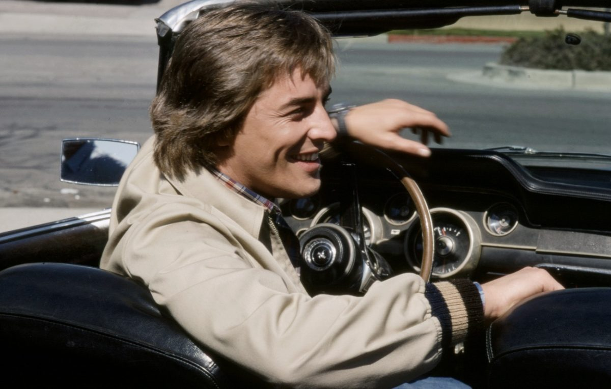 Don Johnson behind the wheel of a car during a 1978 TV shoot