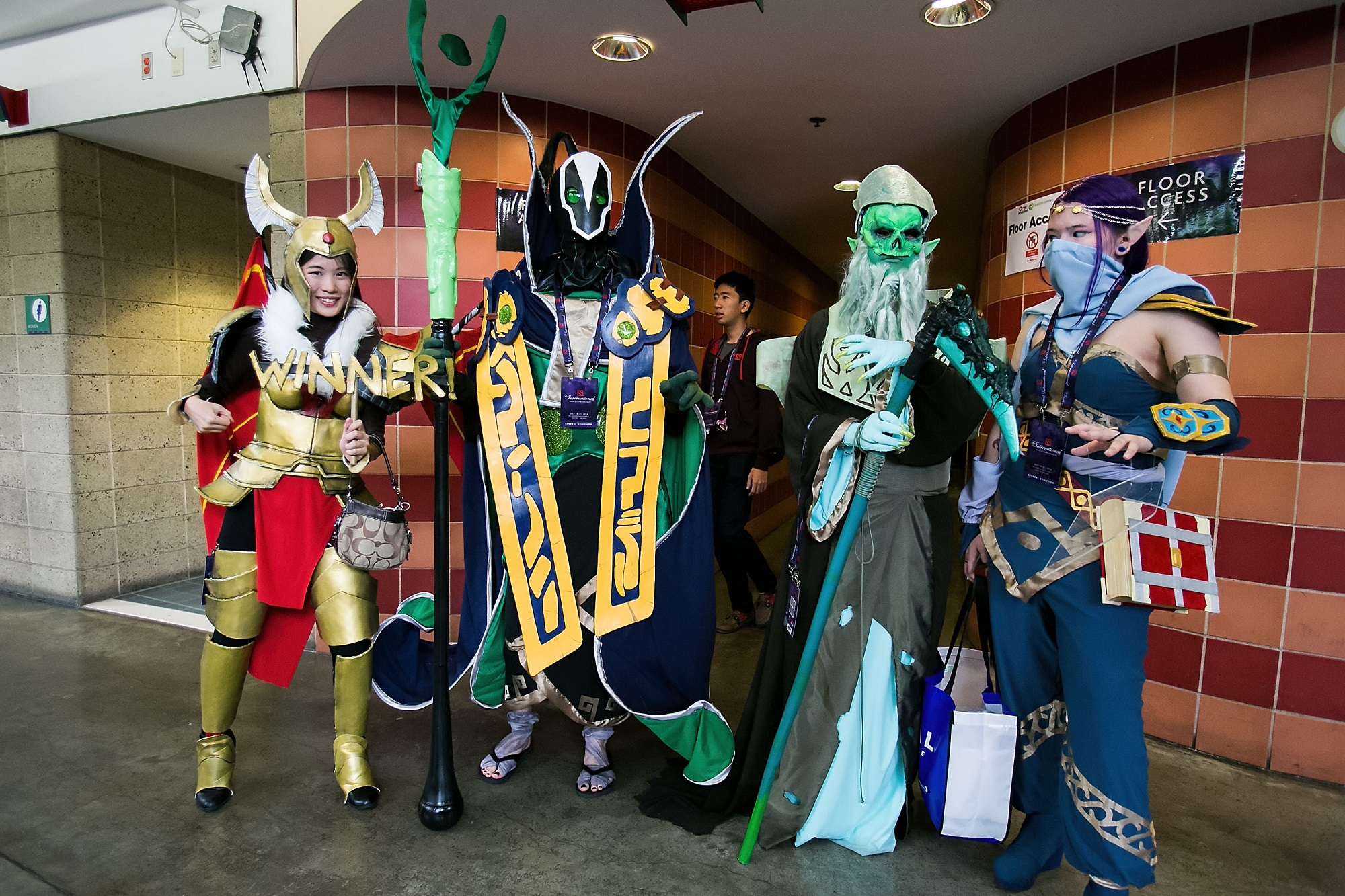 Fans dressed in cosplay pose for a photo at The International Dota 2 Championships on July 20, 2014 in Seattle, Washington.