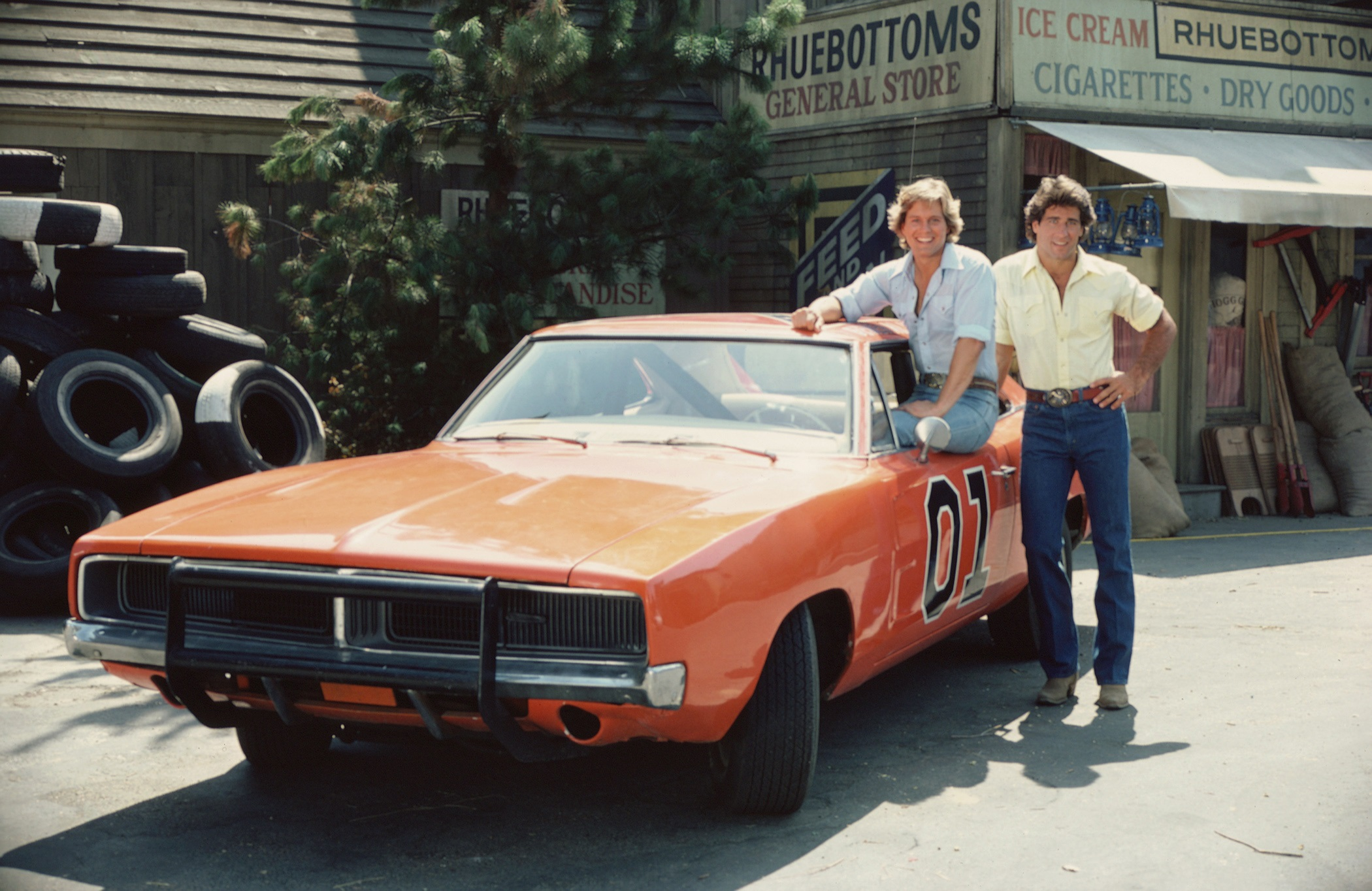 Byron Cherry and Christopher Mayer pose with the iconic The Dukes of Hazzard car