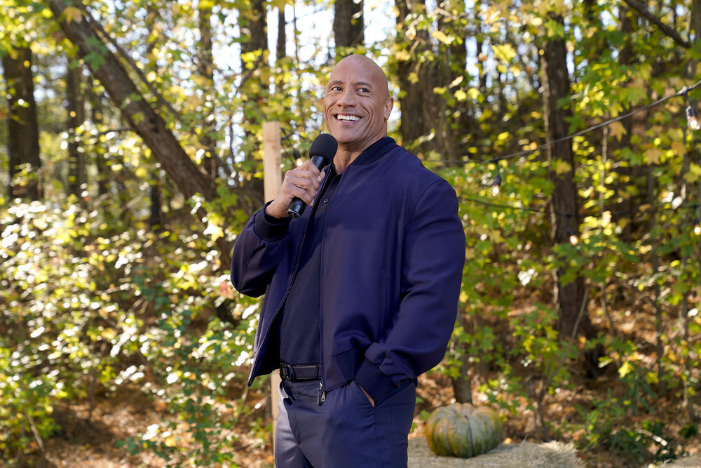 Dwayne the Rock Johnson holding a microphone