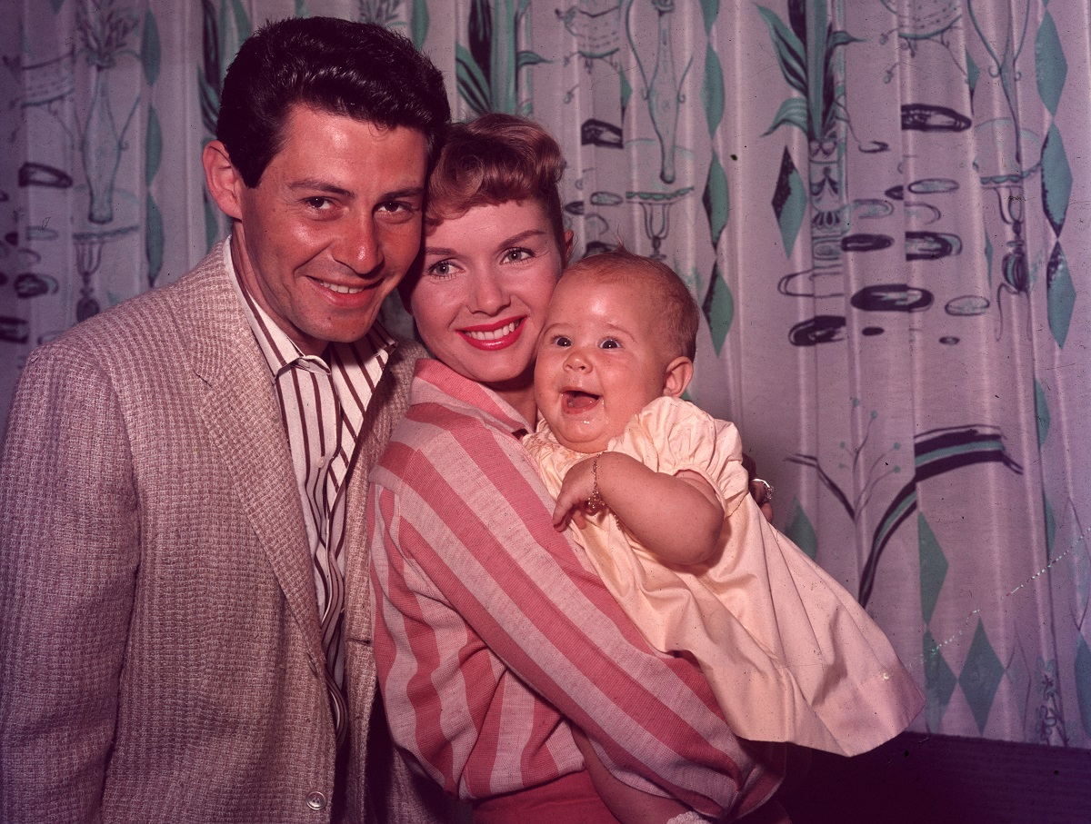 Eddie Fisher and Debbie Reynolds with their daughter Carrie Fisher in 1957.