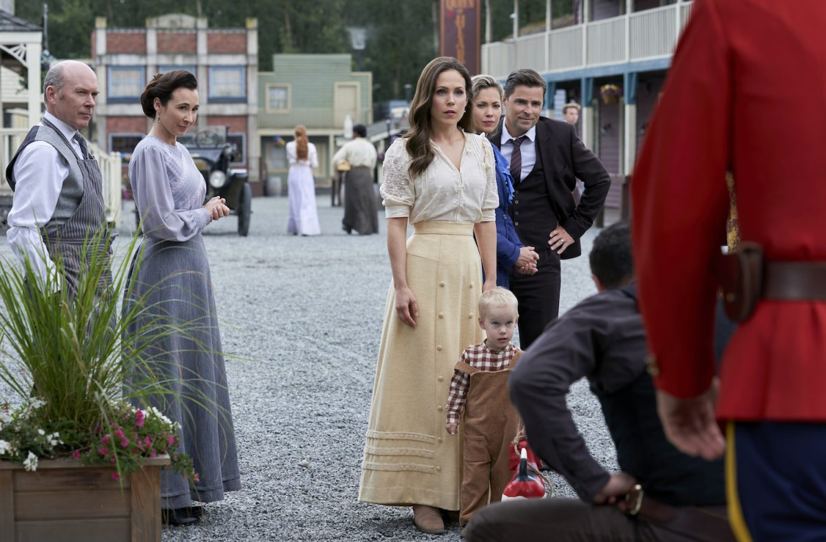 Elizabeth and her son Jack look at a crouching man in the When Calls the Heart Season 8 premeire