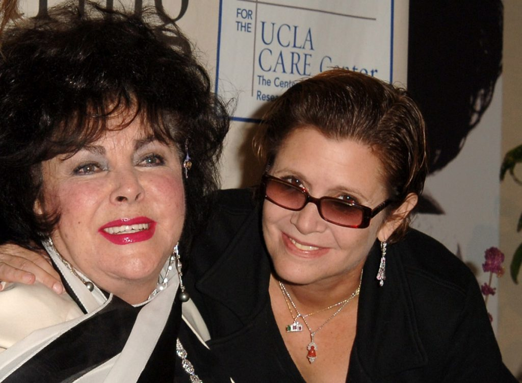 (L-R): Elizabeth Taylor and Carrie Fisher in Los Angeles, California, United States.