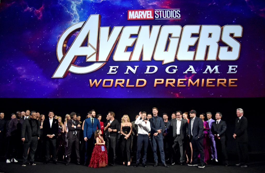 The cast and crew of Avengers: Endgame stands on the red carpet for a group photo.