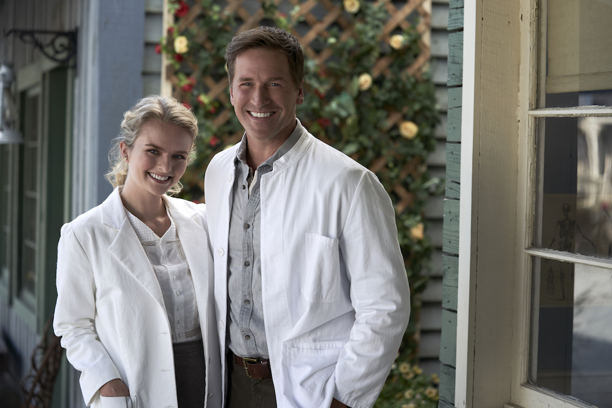 Faith and Carson wearing white coats