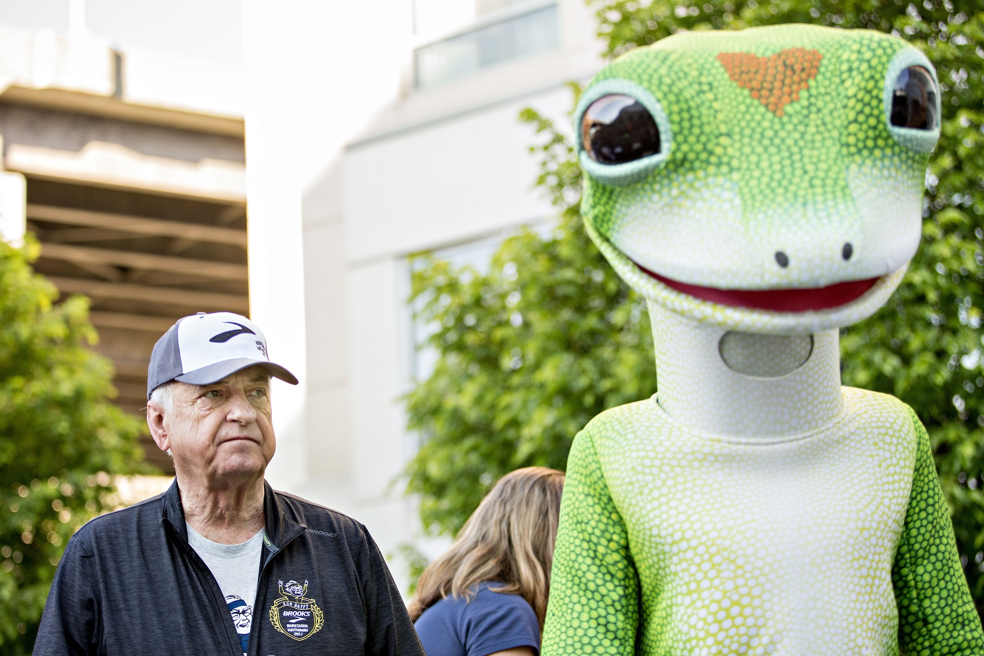Tony Nicely, CEO of GEICO, alongside the GEICO gecko mascot