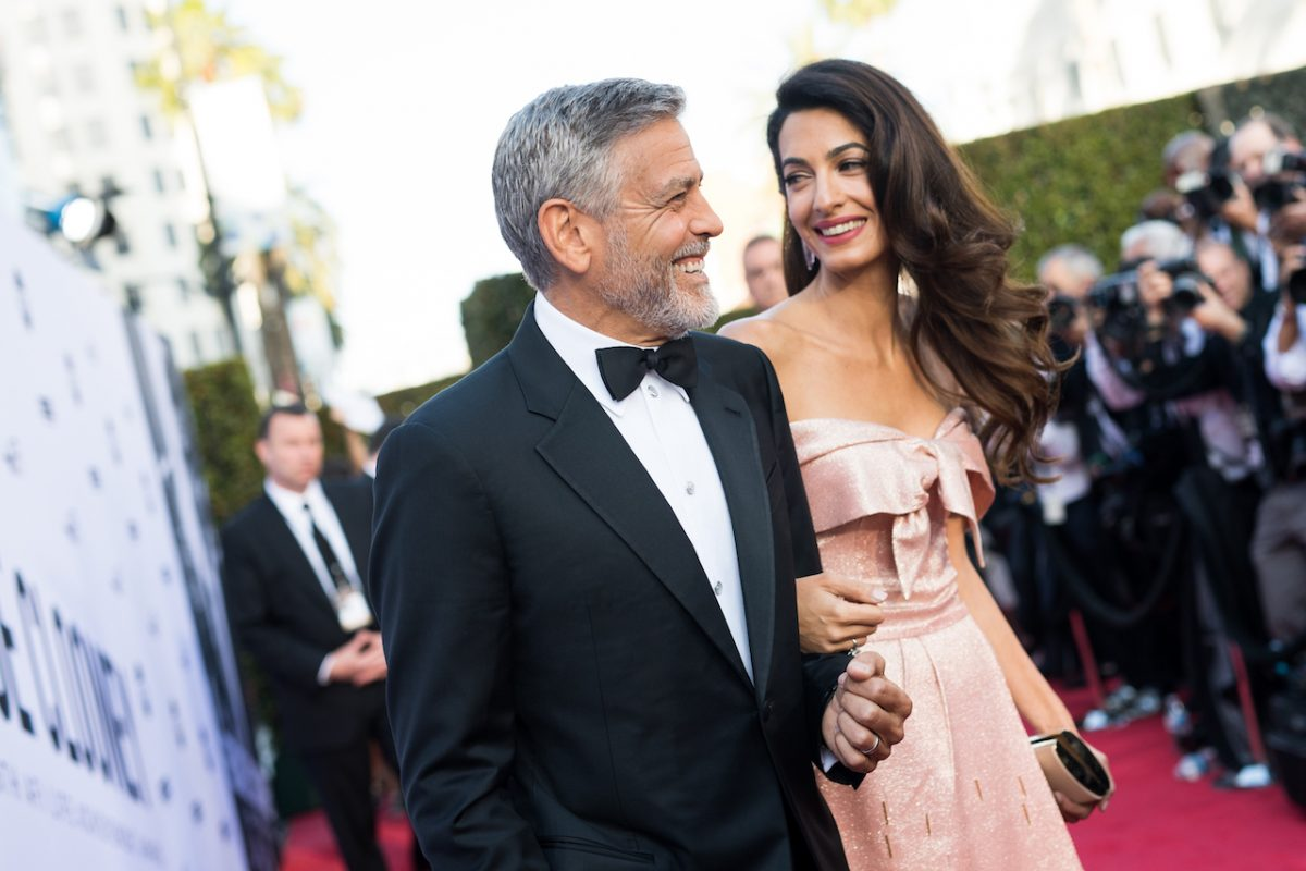 George Clooney and Amal Clooney walk the red carpet together at the American Film Institute's 46th Life Achievement Award Gala in 2018