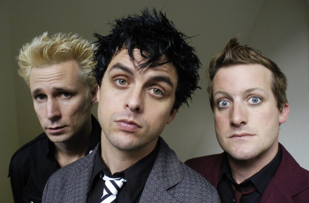 Mike Dirnt, Billie Joe Armstrong, Tré Cool with a grey background