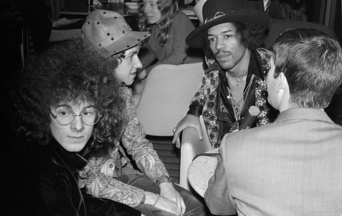 Jimi Hendrix and bandmates speak with a reporter in 1968
