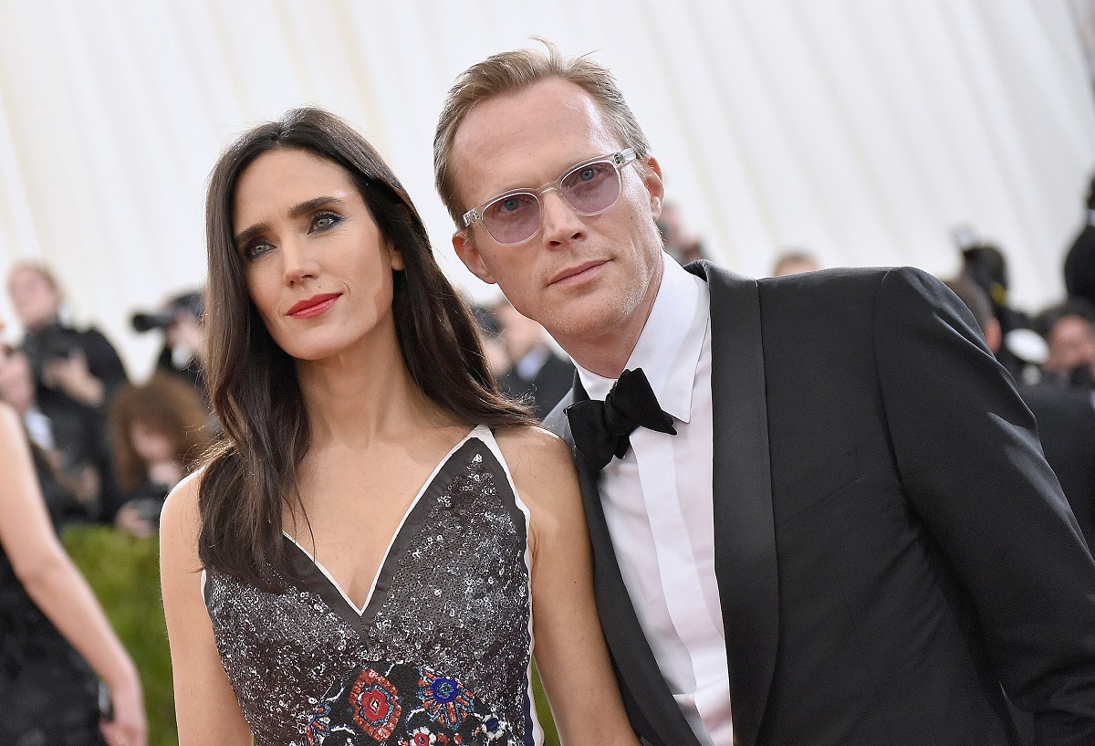 Jennifer Connelly (L) and Paul Bettany pose outside in front of photographers