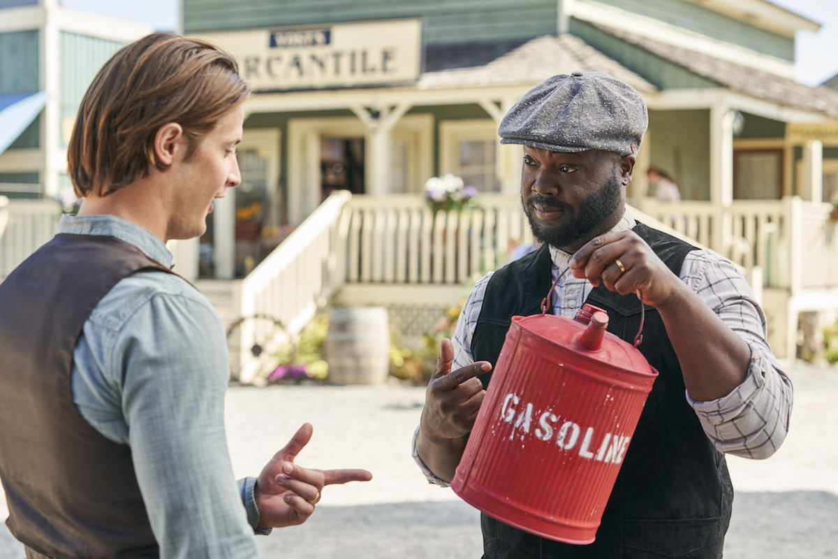 Jesse talks to Joseph, who is holding a gas can, in an episode of When Calls the Heart