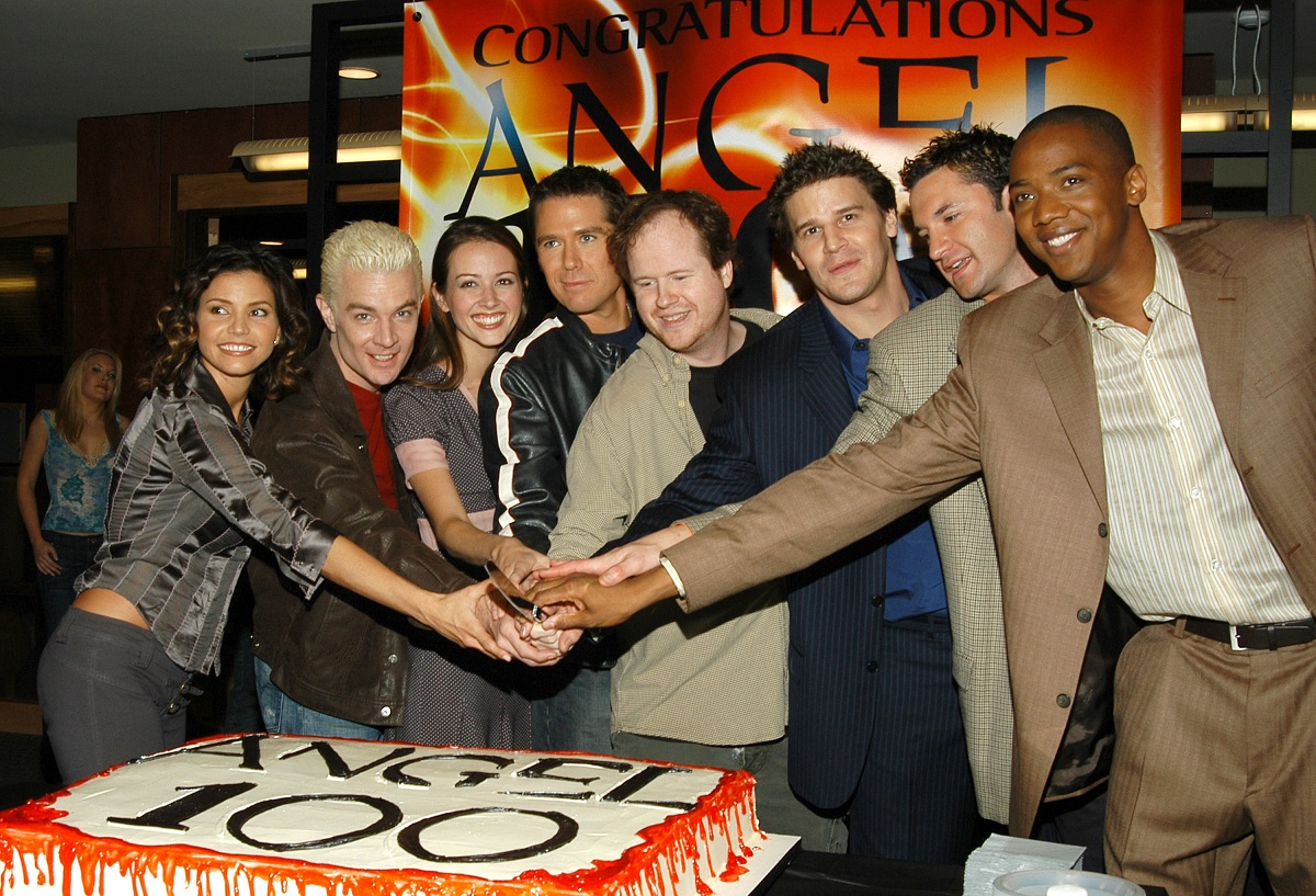 Joss Whedon, creator and executive producer of 'Angel' and cast cut a cake.